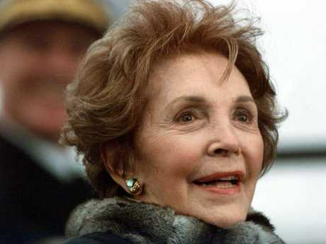 Nancy Reagan looks on during the christening of a US aircraft carrier in 2001