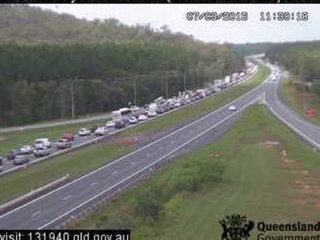 Southbound lanes of the Bruce Hwy queue after a single-vehicle crash about 2km south of the intersection with Johnston Rd at Beerburrum.