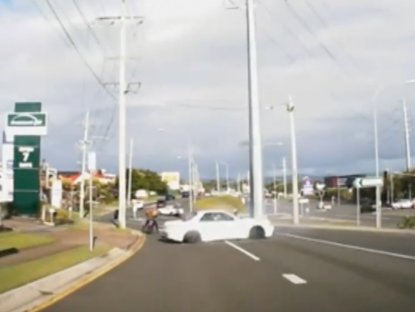 A Gold Coast scooter rider has a narrow miss when a car spins out of control.