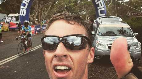 Iain Curry at the top of the KOM Crows Nest Rd during the 2016 Bupa Challenge Tour. Photo: Iain Curry