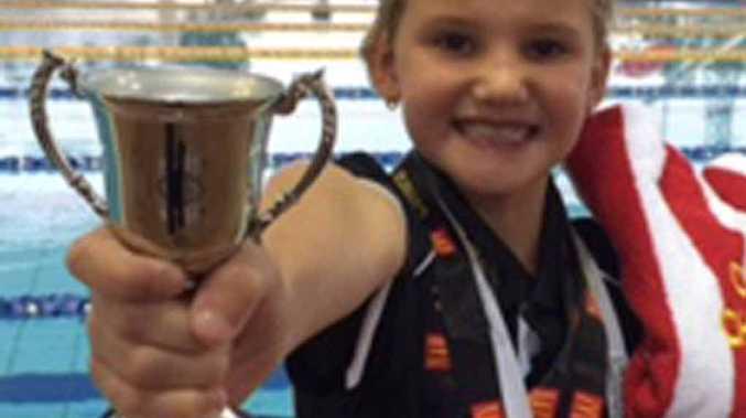 Marlee Chopping, 8, won swim of the meet.