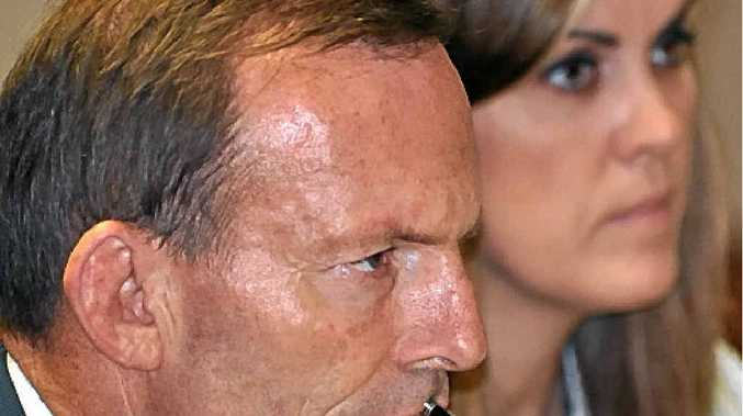 OUSTED: Tony Abbott and Peta Credlin.