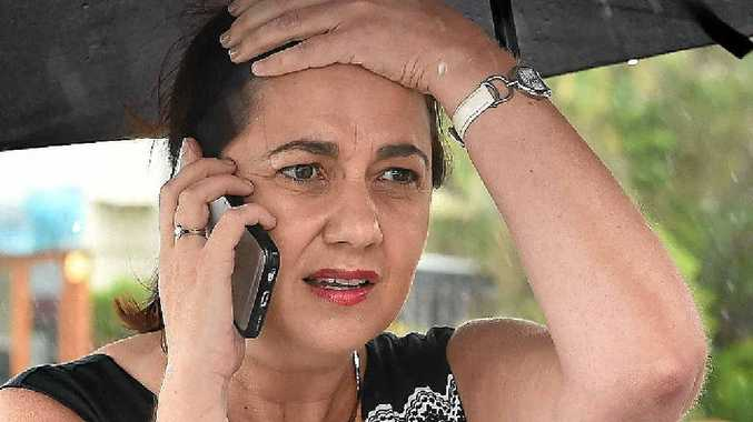 TRYING TIMES: Queensland Premier Annastacia Palaszczuk takes a phone call on the Gold Coast yesterday morning.