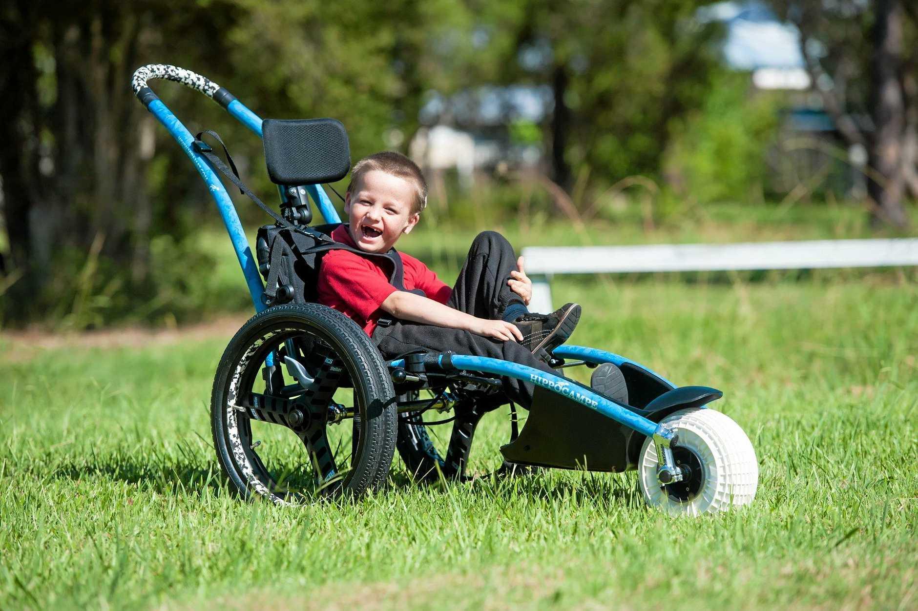 Christian Sheridan-Bridges with his new beach and park wheelchair,