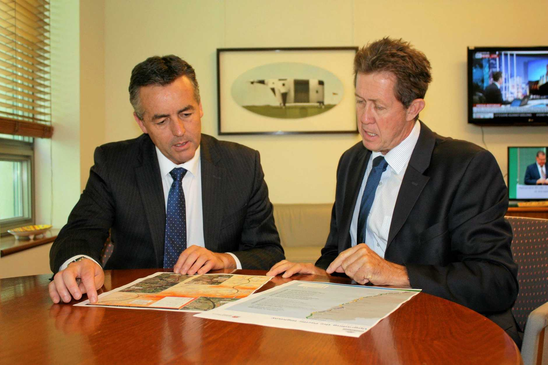 Infrastructure and Transport Minister Darren Chester is shown the plans for a Coffs Harbour bypass by Cowper MP Luke Hartsuyker.