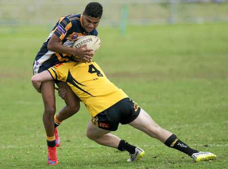 Highfields' Blake Appo is tackled by Gatton's Cam Nicholls in Hutchinson Builders TRL Premiership qualifying semi-final at Gold Park, Sunday, September 6, 2015. Photo Kevin Farmer / The Chronicle