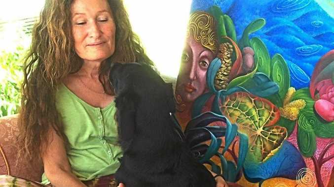MUSE: Marie Louise de Lepervanche with her dog Lucy who is the inspiration for her exhibition at the Iluka Emporium, Lucy and the New World Order.