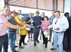 Pre polling at the Brolga Theatre - Ian and Tanya Berthelsen run the gauntlet of election material as they head into vote. Photo: Alistair Brightman / Fraser Coast Chronicle