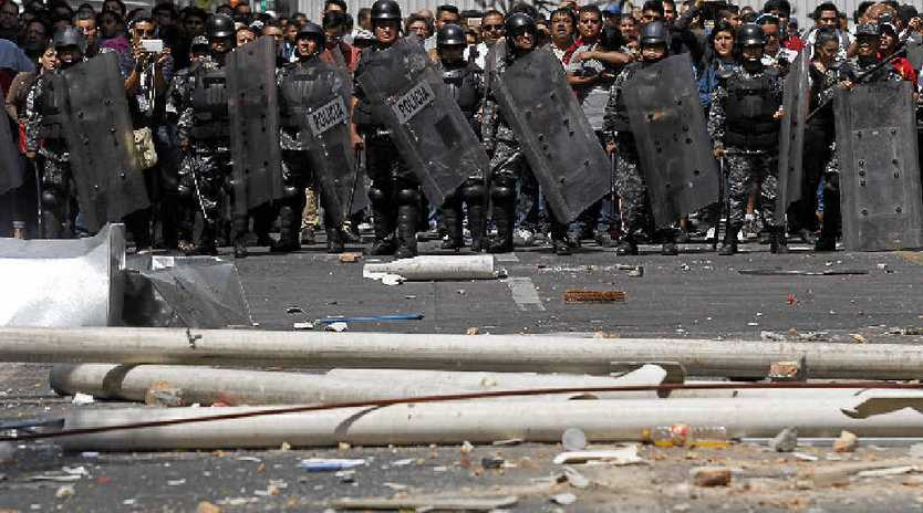 DIVISIVE ISSUE: Police re-establish order in the Mexican city of Guadalajara after an attack on taxi drivers protesting against the Uber transport service.