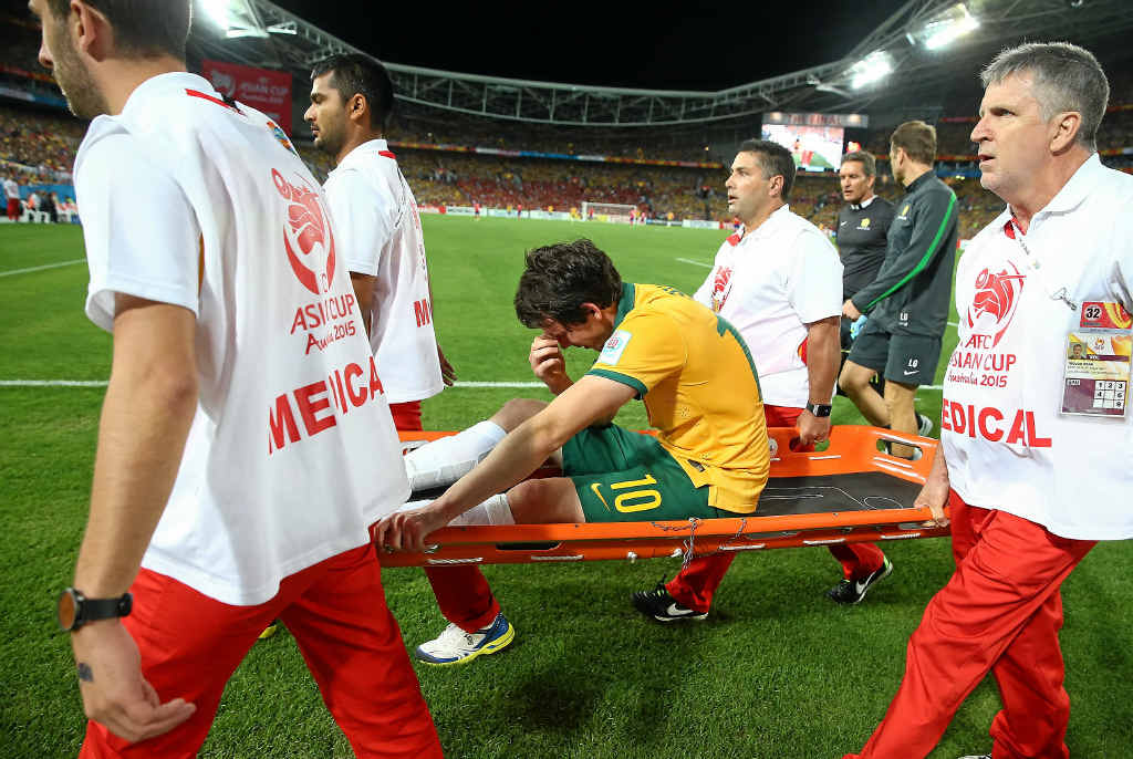 PAINFUL MEMORY: Robbie Kruse is taken off with an Achille injury in the Asian Cup final.