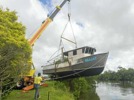 Colin Mather's aluminium trawler is lifted into the channel on South Bank Road.