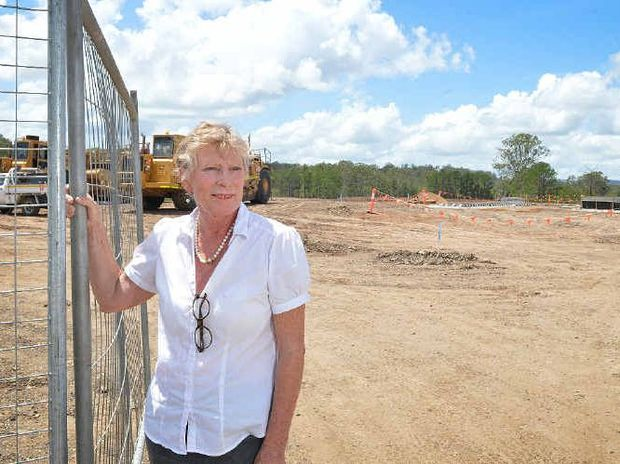 EXCITING TIMES: Curra Country Real Estate principal Robyn Nelmes at the new United service station site which she says will help the Bruce Hwy bring wealth to the area.
