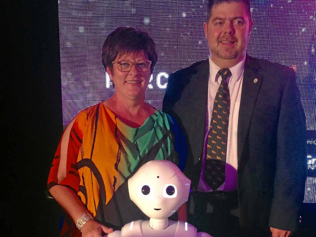Mayor Deirdre Comerford and CQUniversity deputy Vice-Chancellor Pierre Viljoen meet Pepper the robot.