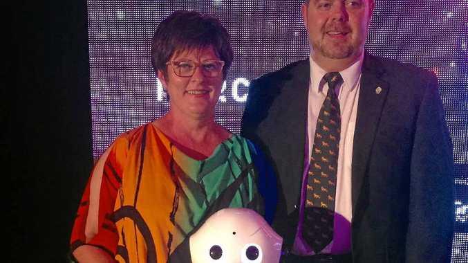 Mayor Deirdre Comerford and CQUniversity deputy Vice-Chancellor Pierre Viljoen meet Pepper the robot.