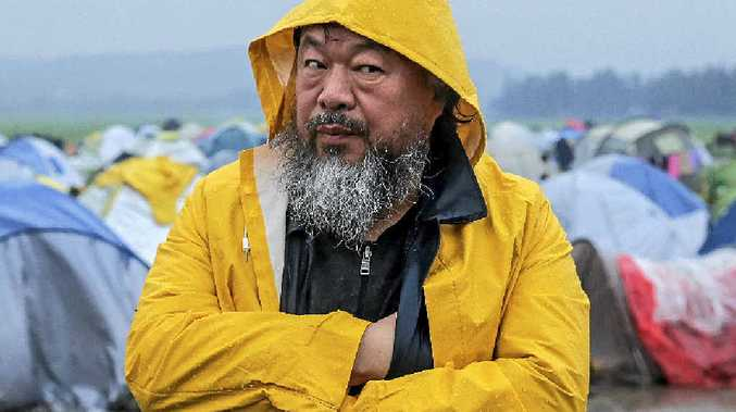 DRAWING ATTENTION: Chinese artist and activist Ai Weiwei visits refugees at a camp near Idomeni, on the border between Greece and Macedonia. The artist has been focusing on the plight of refugees in recent months, spending time living on the Greek island of Lesbos.