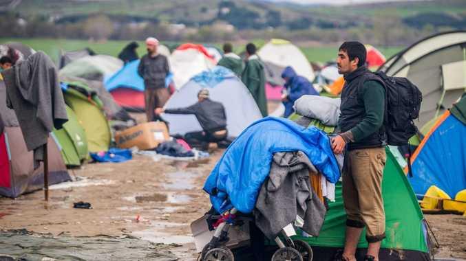 STUCK: Asylum seekers wait on Greece's border with Macedonia.