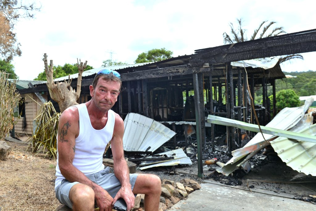 Shane Evans surveys fire damage to his Beerwah home.