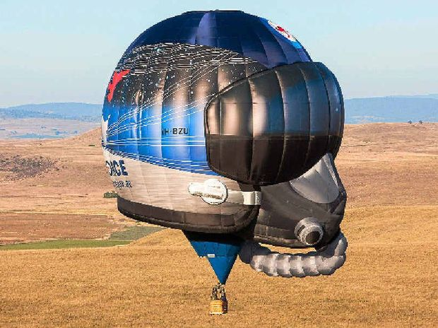 ON SHOW: The Royal Australian Air Force has brought a new hot air balloon into service. The unique shape of the balloon is distinctively air force, representing a fighter pilot's helmet.