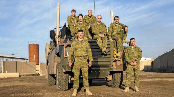 FROM CABARLAH TO IRAQ: After training on the Darling Downs these seven soldiers (back, from left) Corporal Luke Preston, Lance Corporal Sam McKinnon, Lance Corporal Cameron Harding, Lance Corporal Anthony Brider and Signaller Luke Wiskin, as well as (front, from left) Lieutenant Tristan Ross and Sergeant Andrew Gillies are now serving in Iraq.