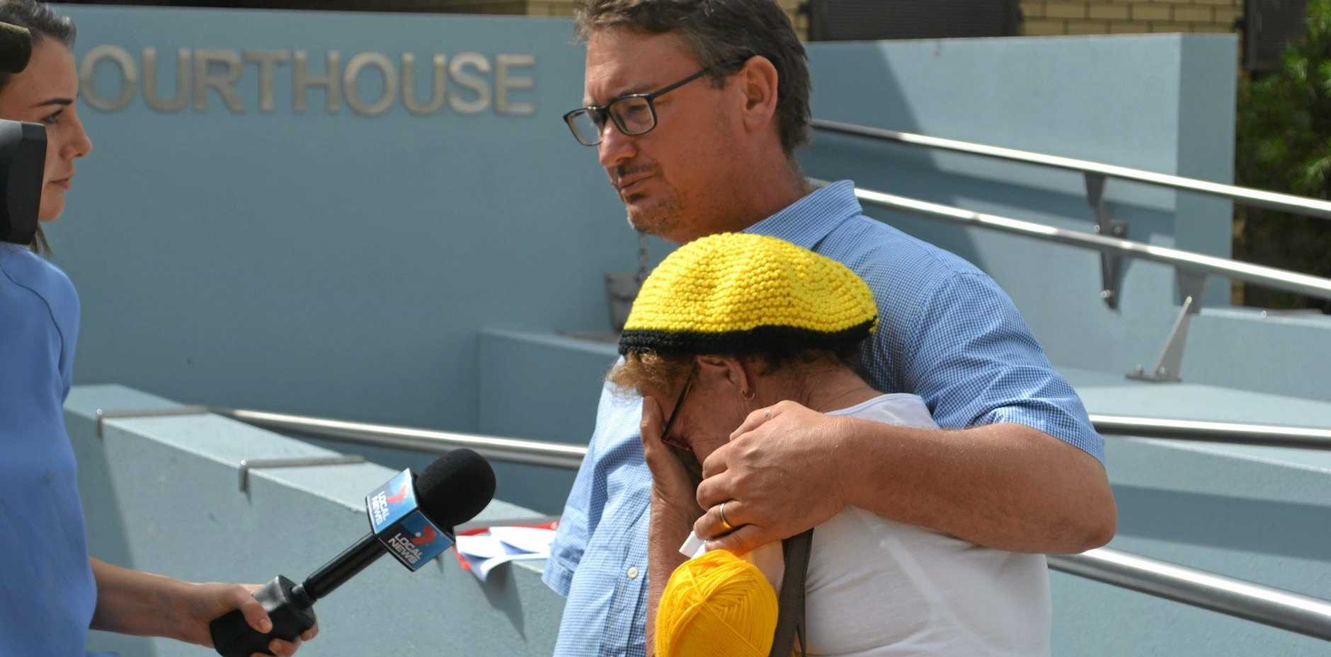 LINC CHARGED: Brian Bender and his mother, Pam, after an emotional day in Dalby Magistrates Court during which Linc Energy was formally charged for alleged environmental harm in the Hopeland farming belt, near Chinchilla.