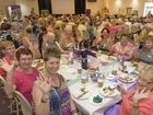 The ladies from Oyster Cove give a wave at the International Women's Day event at Yamba Bowling Club.