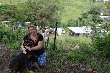 Spring St, Mt Morgan resident Narelle Smith and pet dog Zues who alerted the family to an abandoned house on fire next door which was threatening their home.