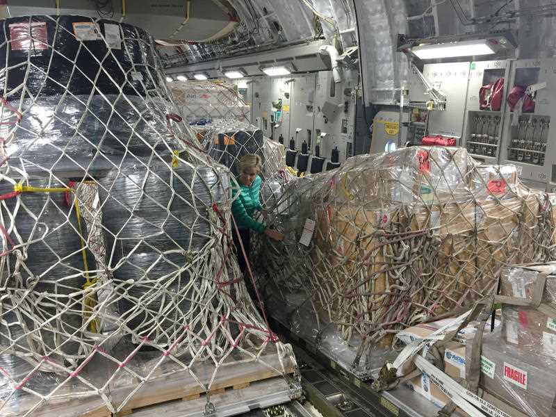 Australian Foreign Minister Julie Bishop inspects pallets and packages of Australian aid on a C17 bound for Fiji, Canberra, Sunday, March 13, 2016. The minister will visit communities hit by cyclone winston and meet Australian aid workers helping locals rebuild.