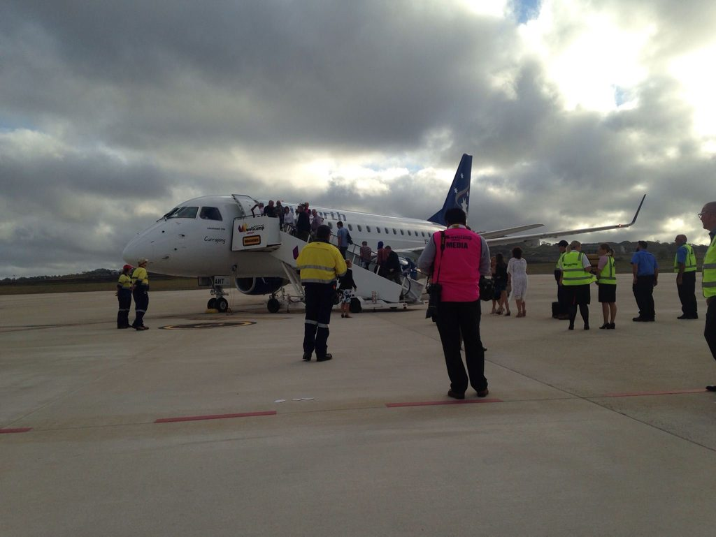 Passengers board the first flight for Airnorth out of Wellcamp.