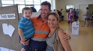 EARLY BIRDS: Steven and Kylie Heit took their son Lachlan, 2 along to vote this morning at the pre-polling booth on Hanson Rd. Photo Helen Spelitis / Gladstone Observer