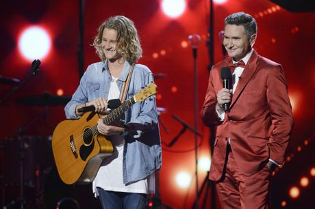 Australia's Got Talent finalist Fletcher pictured with host Dave Hughes.
