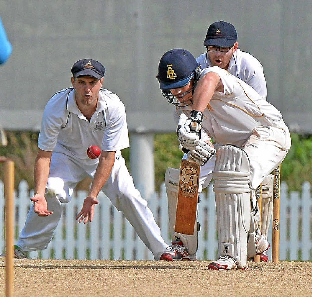 KNUCKLING DOWN: Gympie batsman Lewis Waugh and, in slips for Maroochydore, Adam Thornton.
