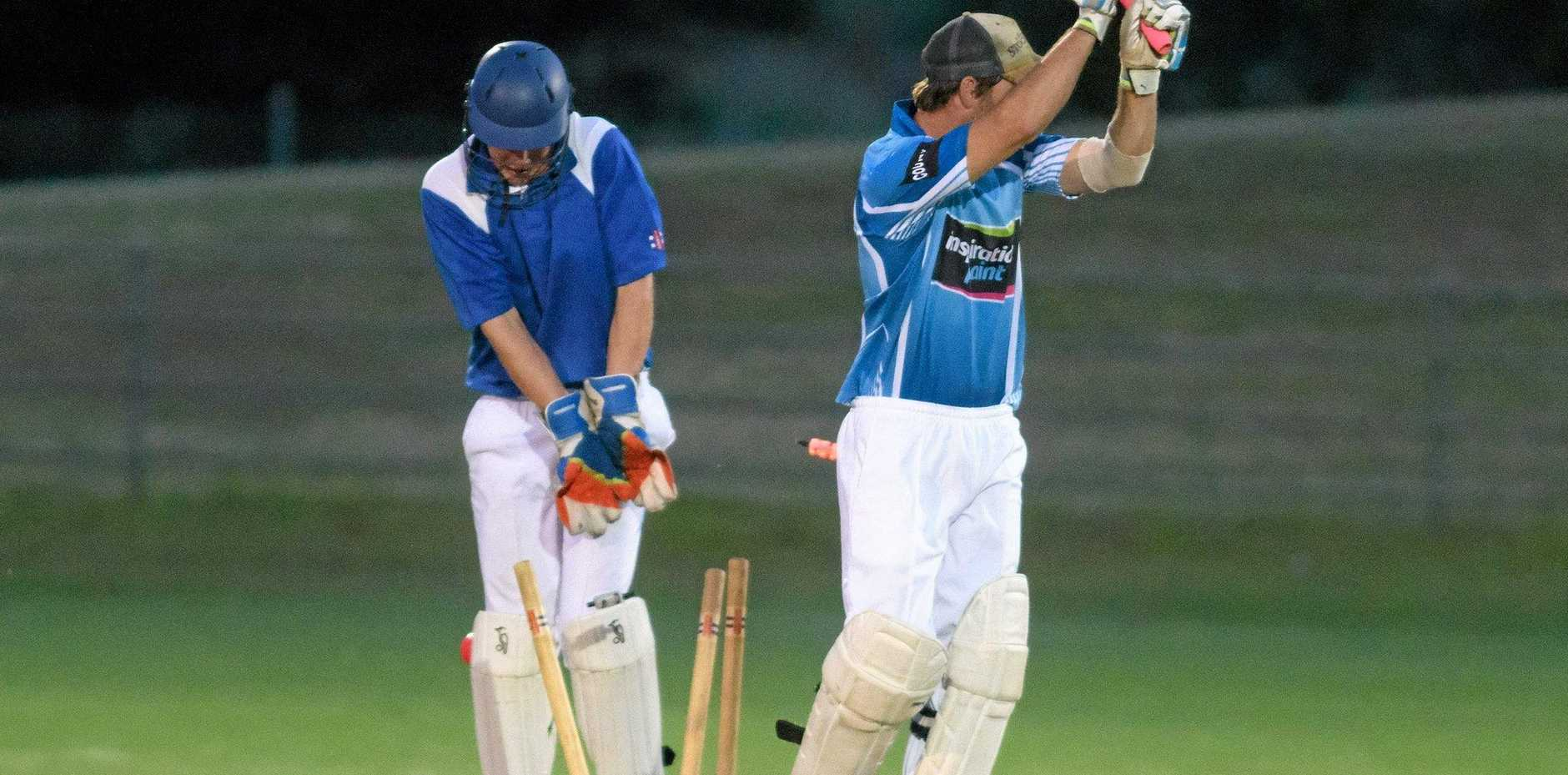 Coutts Crossing's Corey Kempshall is bowled in the night cricket grand final at McKittrick Park.