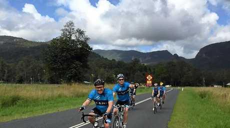 CYCLE SPEED: SBS presenter Michael Tomalaris rides through the Tweed hinterland on Friday.