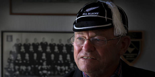 Neil Wolfe, dementia sufferer and All Black, wearing his All Blacks cap and jacket, at his home in New Plymouth.