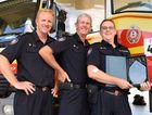 Torquay station officer Jason McCloskey, senior firefighter Len Gleeson and senior firefighter Mal McKay with the special award. Photo Hannah Baker / Fraser Coast Chronicle