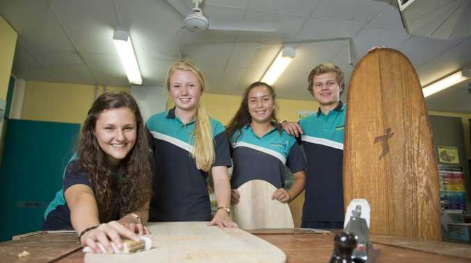 SURF'S UP: Leonie Machnitzke, 16 from Germany, Sunniva Brown-Pedersen, 17 from Norway, Linda Michaelsen, 17 from Norway and Kilian Lampe, 16 from Germany all created body boards as part of the Tannum Sands State High School international students program. Photo Paul Braven / The Observer