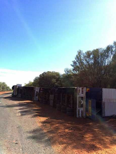 A B-triple road train rolled on the Mitchell Highway about 20km south of Charleville this morning. Photo: Charleville Neighbourhood Watch