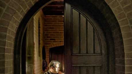 Attilla Sautov tunes up before his performance in the Christ Church Cathedral.