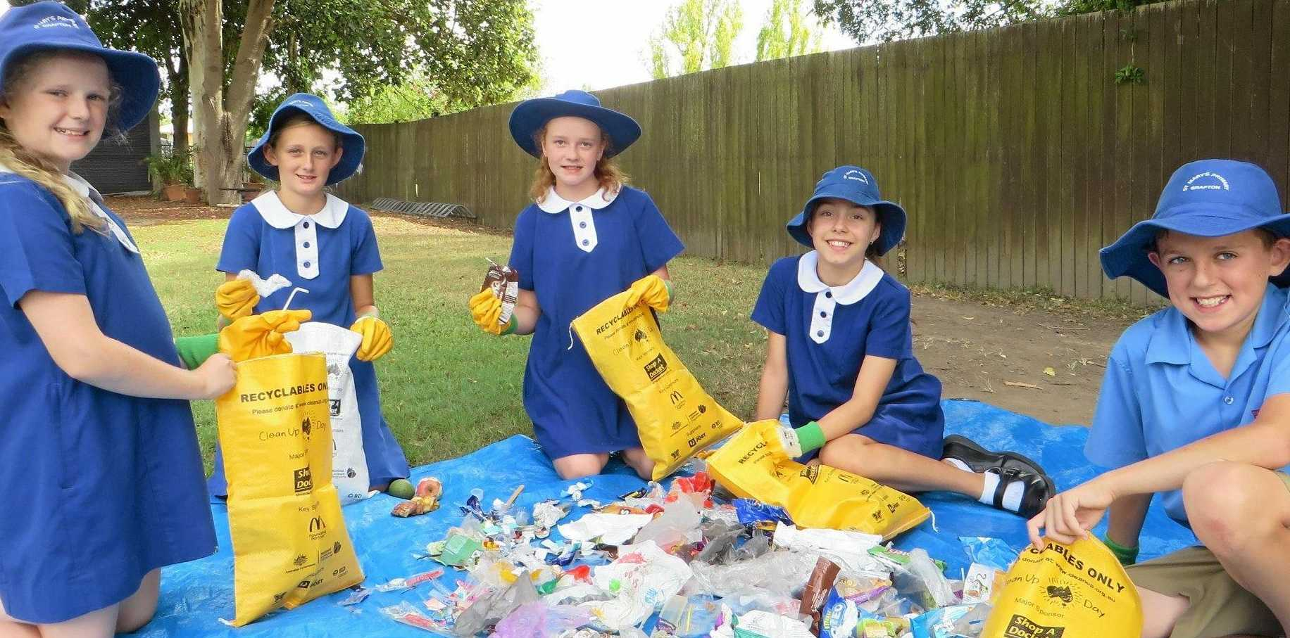 Charlotte, Abby, Ashleigh, Nadine and Dominic, Environmental Leaders at St Mary's Primary Grafton, sorted rubbish during Clean Up Australia Day activities.
