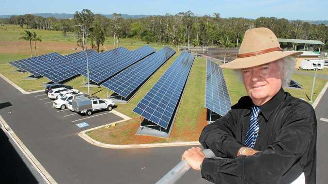 Ballina's mayor, Cr David Wright, with the bank of solar panels powering the Ballina wastewater treatment plant. Photo Graham Broadhead / Ballina Shire Advocate