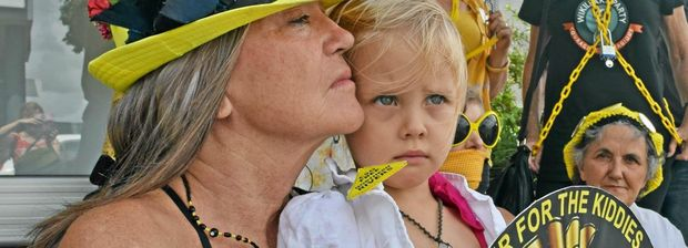 Daniele Voinot Sledge with granddaughter Matisse Sledge (3 years) and Knitting Nannas Against Gas outside Thomas George's office, standing in solidarity against the Baird Government bill to increase police powers to arrest peaceful protesters.
