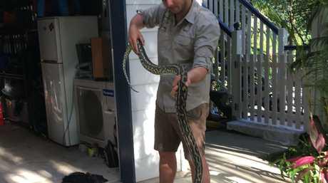 Sunshine Coast Snake Catchers 24/7's Max Jackson with the giant python.
