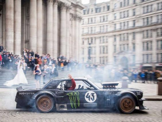 Top Gear host Matt LeBlanc waving to a bride and groom at St Paul's Cathedral in London.