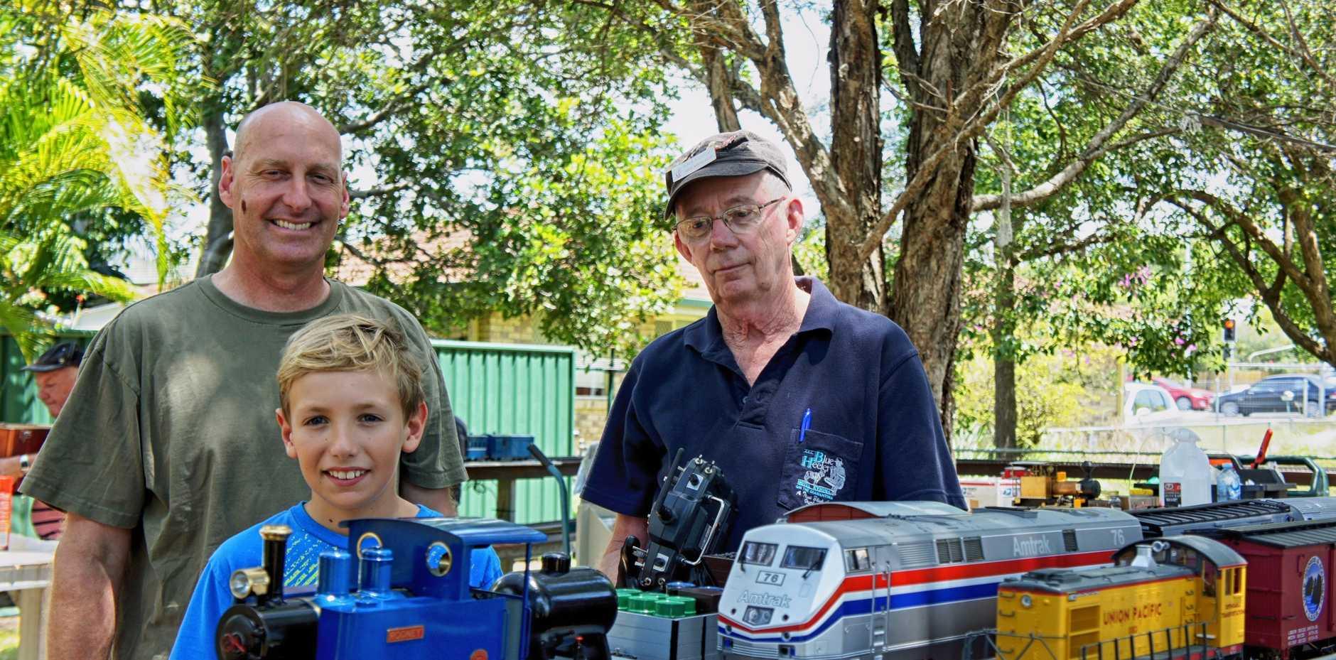 AMRA members Will Monroe, Alex Monroe and John Moorhead operating the garden G scale model trains.