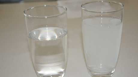 Tank water compared to town water in Hodgeson Vale. Photo Andrew Backhouse / The Chronicle
