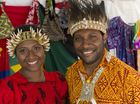 Tania Ona and Stotick Kaprangi are a colourful pair in their Papua New Guinea stall at Harmony Day celebrations at USQ, Wednesday, March 16, 2016.