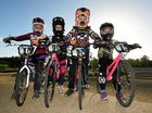 BRINGING IT HOME: Maryborough BMX Club members Alyssa Cherries, Teya Rufus, Colton Blyth and Shae Rufus. All four earned Australian plates at the national titles in Bathurst and (right) the quartet have fun at the track. Full club results at our website.