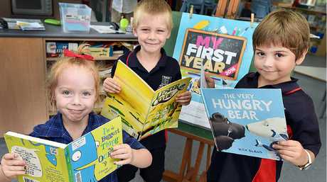 GREAT READS: Pialba State School Prep M students (L) Tiahmi Ledgard-Thomson, Cameron Shaw and Valentino Mendez are just three of more than a thousand prep kids photographed for the My First Year lift-out.