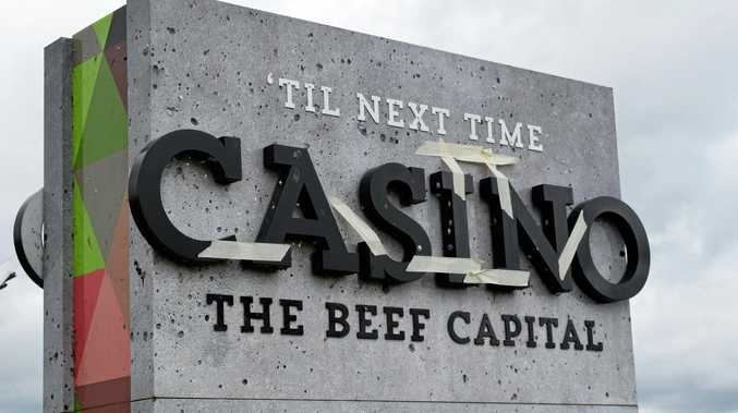 Casino's town entry sign on the Bruxner Highway (the side facing towards Casino) with tape on the letters.