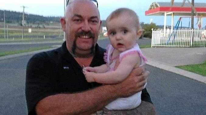 BRAVERY: Brad Morrison with baby Paige Costello who he rescued from a burning car at just nine months old in November 2013.